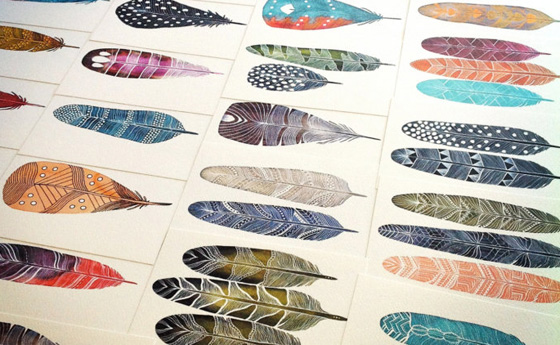 Feathers and stones painted by Marisa Redondo
