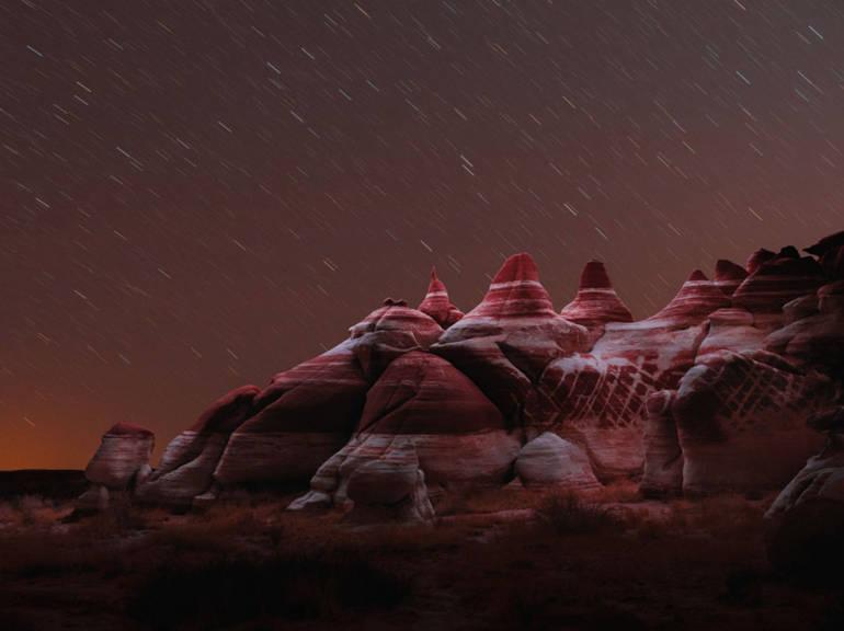 Rocks illuminated by a drone, Reuben Wu